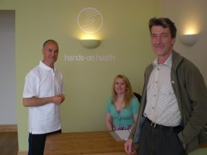 Ben Chapple (right) - the first patient at Hands-on Health - with Albie McMahon (left) and Samantha Shanks