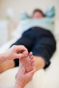 A reflexology treatment in progress