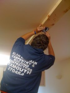 James fixes the x-mount to the new wooden beam