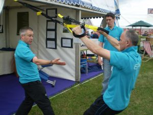 Rob and Albie demonstrate TRX at the Devon County Show