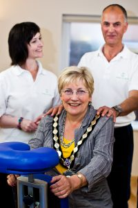 Exmouth's mayor, Sandy Sutton, tries out seated massage from Albie McMahon. Nutritionist Lesley Harper looks on.