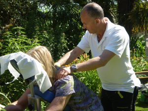 Albie gives a shoulder massage to one of the organisers, in the sunshine