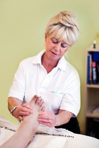Sue Arnold with a reflexology patient