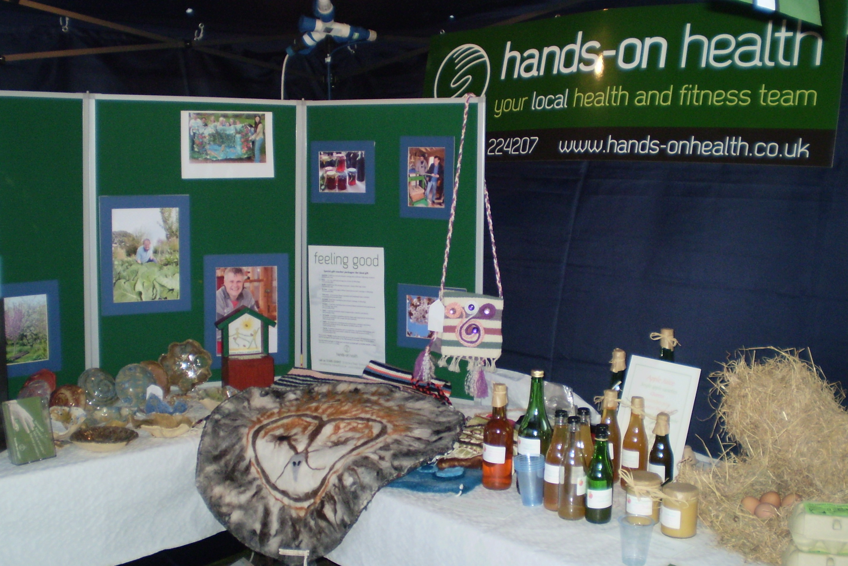 Part of the shared stand, with a feltwork yoga mat featuring an owl in the foreground. Yoga mats can be made to commission.