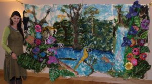 Stallcombe House art teacher Sam Smith with the feltwork wall hanging