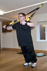 Richie Evans does a TRX chest press at Hands-on Health, Exmouth