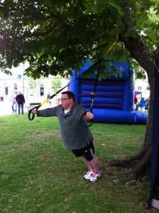 Richie demonstrates TRX in The Strand, Exmouth