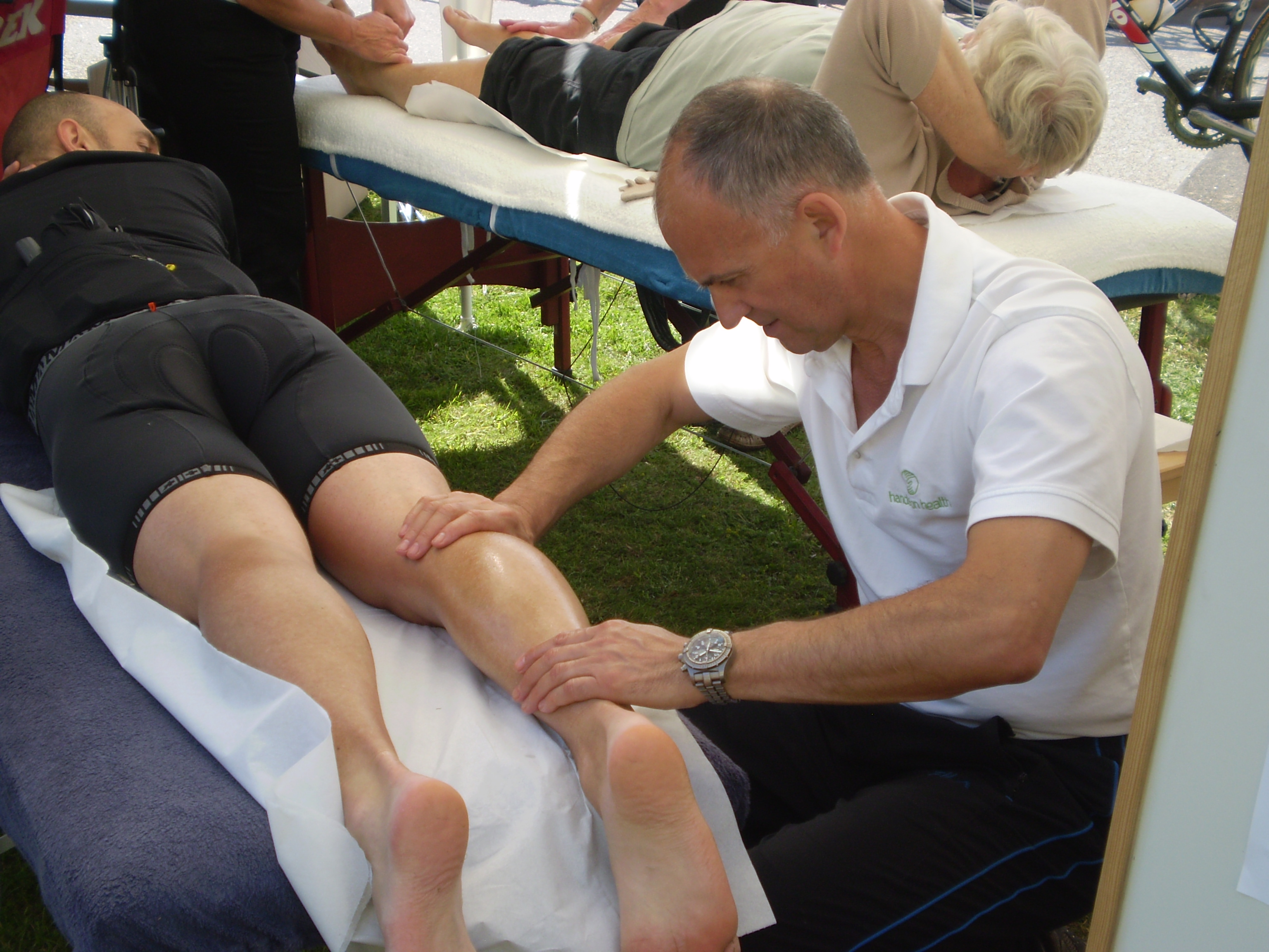 Athlete having calf massaged after an event