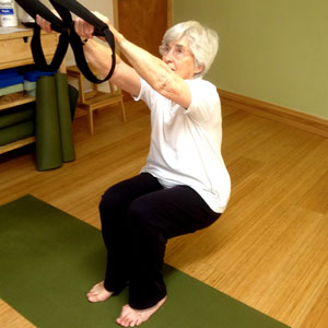 A one to one TRX class with an older lady