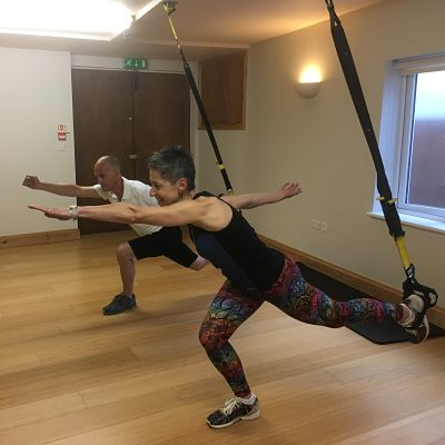 Male and female TRX lunge